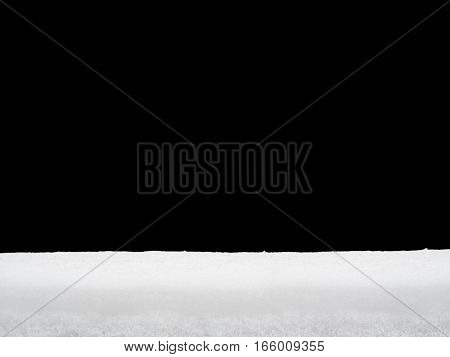 Pile of snow or snow cap isolated on black background