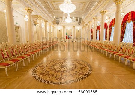 KAZAN, RUSSIA - 16 JANUARY 2017, City Hall - luxury and beautiful touristic place - golden ballroom - flags of Russia, Tatarstan and the town, wide angle