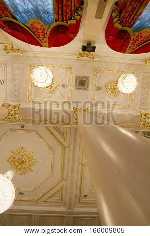 KAZAN, RUSSIA - 16 JANUARY 2017, City Hall - luxury and beautiful touristic place - ceiling in golden ballroom, vertical, wide angle