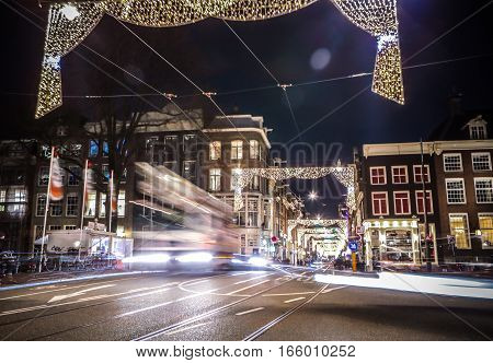 AMSTERDAM NETHERLANDS - JANUARY 11 2017: Headlights car passing down street at night. Time Lapse. January 11 2017 in Amsterdam - Netherland.