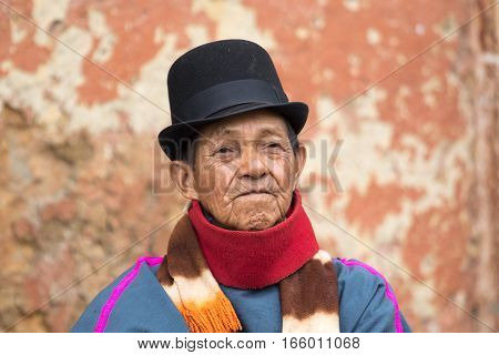 September 6 2016 Silvia Colombia: portrait of a Guambiano indigenous man dressed in traditional clothing and a Bowler hat