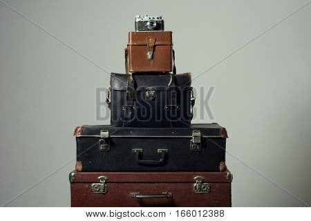 Stack Of Old Shabby Suitcases And Camera