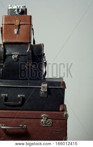 Stack Of Vintage Shabby Suitcases And Camera