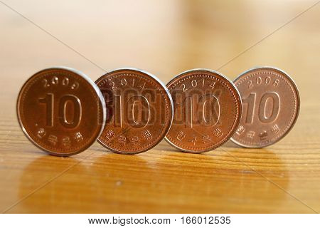Korean coins over blurred background. South Korea 10 won coin