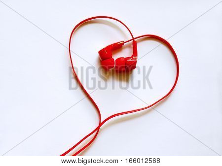 Headphones earphones red heart shape on white background / Love music