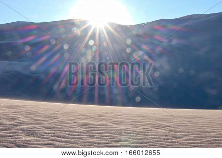 Sun rays over sand dunes. Great Sand Dunes National Park and Preserve. Denver. San Luis Valley. Alamosa Saguache County Colorado. United States.