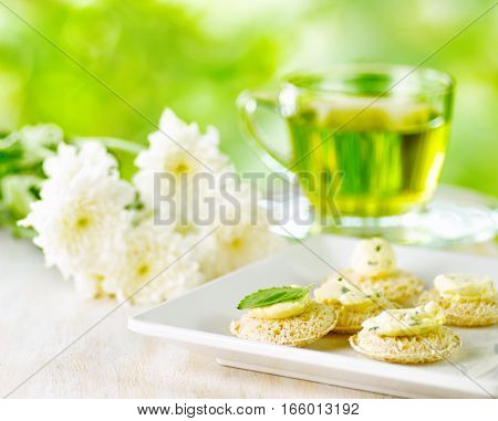 Several Canapes And Cup Of Herbal Tea.