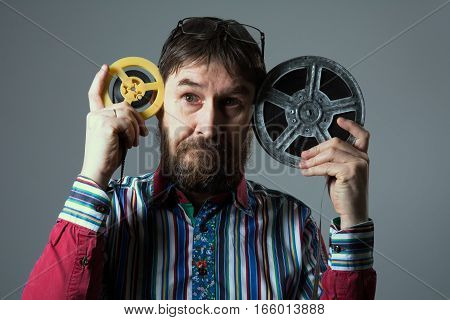 Bearded Man With Two Film Reel
