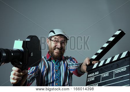 Screaming Man Retro Movie Camera And Clapperboard