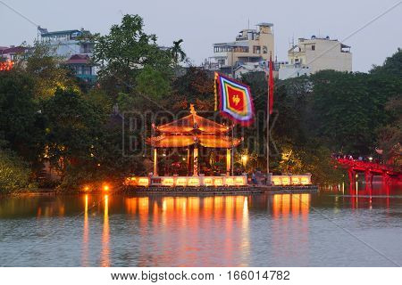 HANOI, VIETNAM - JANUARY 11, 2016: The Buddhist temple of the Jade mountain on the lake Hoankyem in evening twilight