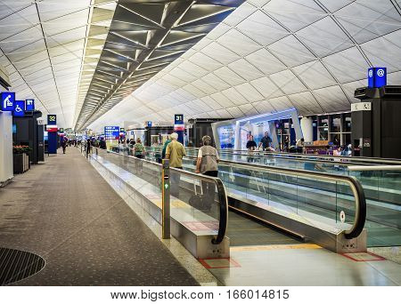 Hong Kong, China - Oct 30, 2016: Inside Hong Kong International Airport - departure level. Image features a mass people-mover escalator.
