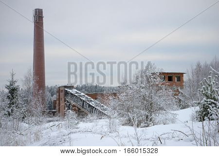 Ruins of an abandoned pulp and paper plant in the village of Harlu winter day. Karelia