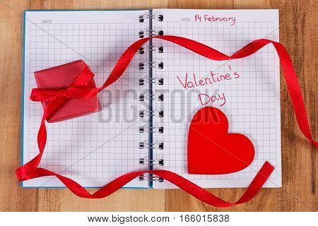 Valentines Day Written In Notebook, Wrapped Gift And Heart, Decoration For Valentines