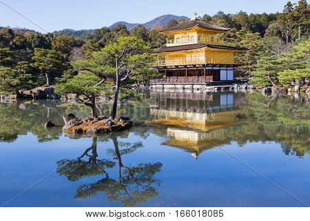 Kinkaku-ji called Golden Pavilion) is a Zen Buddhist temple in traditional japanes garden Kyoto Japan.