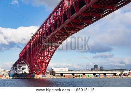Red Bridge Minato Bridge over Osaka sea port Japan