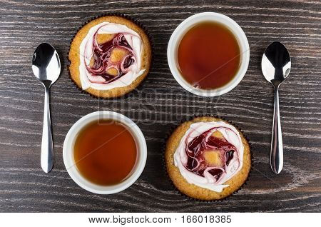 Cakes And Tea In Cups, Teaspoons On Table