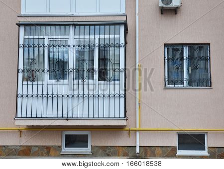 KIEV UKRAINE - JANUARY 23 2017: Close up on window iron security bars installation. Windows lattices.