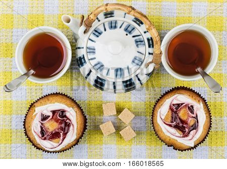 Tea In Cups, Two Cakes, Lumpy Sugar And Teapot