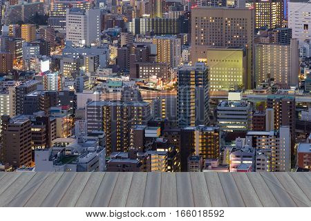 Opening wooden floor city central business district night view Osaka Japan