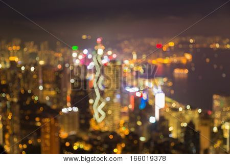 Aerial view blurred lights Hong Kong city over sea port abstract background