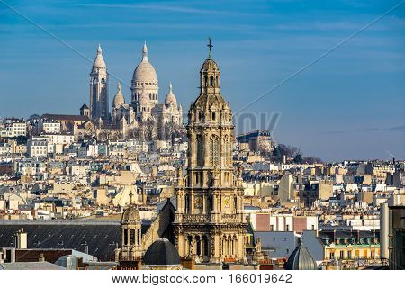 Rooftops of Paris with view of the Sacre Coeur Basilica in Montmartre and the Trinity Church. 18th Arrondissement Paris France