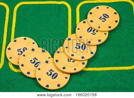 tick of poker chips, poker is played on such's plastic chips