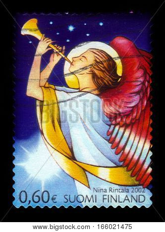 FINLAND - CIRCA 2002: a stamp printed in Finland shows angel playing the flute, series Christmas, circa 2002
