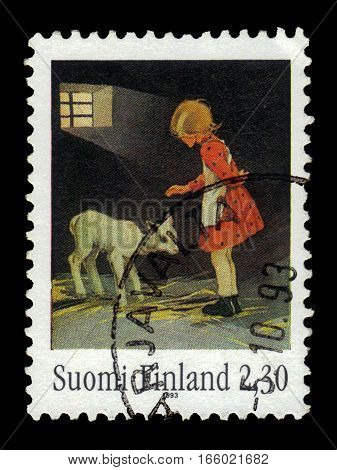 FINLAND - CIRCA 1993: a stamp printed in Finland shows girl with lamb, drawing by Martta Wendelin, illustrator fairy tales, 100th Birth Day of Martta Wendelin, circa 1993