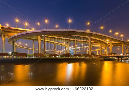 Highway interchange river front wih twilight sky background