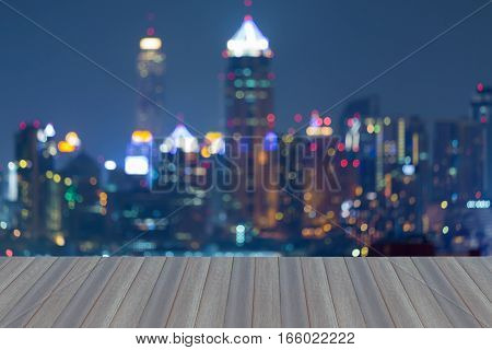 Opening wooden floor blurred lights city business downtown night view