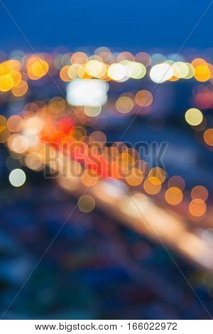 Twilight blurred bokeh lights highway road curved abstract background