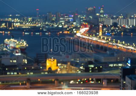 Abstract blurred bokeh light Kobe city downtown by thr bay with twilight background