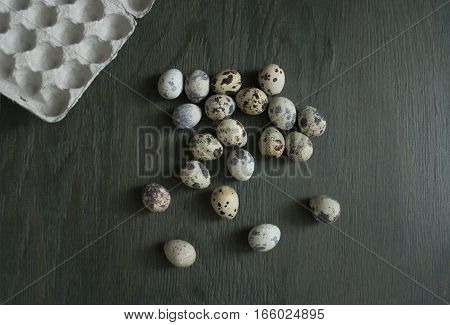 quail eggs on a green table. Cooking healthy food.