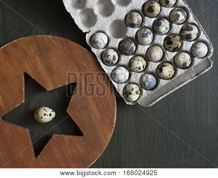 Quail eggs in a cardboard box. Eco-product in environmentally friendly packaging.