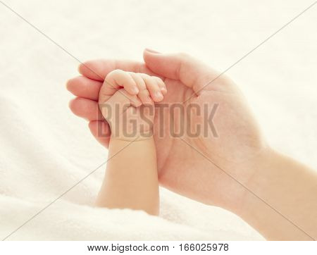 Baby Hand and Mother Hands Woman Holding Newborn New Born Kid Help