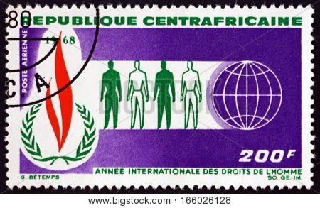 CENTRAL AFRICAN REPUBLIC - CIRCA 1968: a stamp printed in Central African Republic shows Human Rights Flame Men and Globe circa 1968