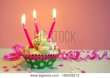birthday cake with whipping cream, hearts and gift ribbon