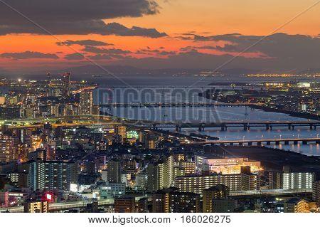 Sunset over Osaka city and river skyline Japan