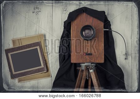 The old studio camera and two old photos.The stylized photo