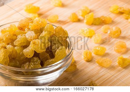 Top Macro View Of The Big Raisins In A Glass Bowl