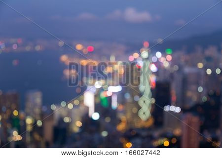 Blurred lights aerial view Hong Kong city over Victoria bay abstract background