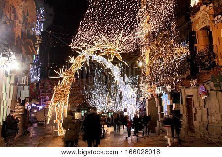 abstract expressionist photograph of Christmas decorations iin the street of the city of Toledo, Spain,  Castilla La Mancha,