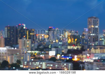 Blurred bokeh light office building with twilight sky background