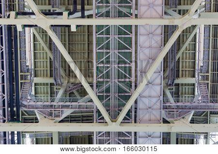 Steel construction background under the bridge architecture background