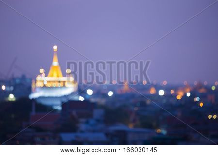 Abstract blurred light Golden pagoda temple Thailand at twilight