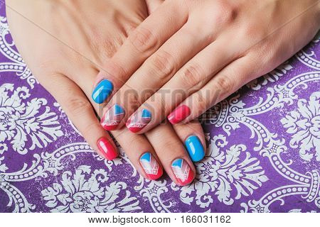 Nail Art With Bright Pink And Blue Chevron Pattern