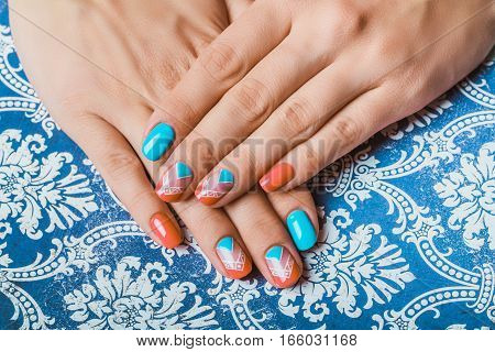 Nail Art With Bright Orange And Light Blue Chevron Pattern