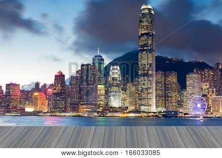 Opening wooden floor Hong Kong office building business downtown over Victoria sea port