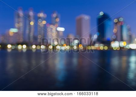 Office building blurred lights with reflection with twilight sky abstarct background