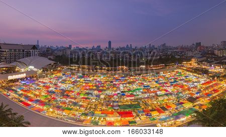 Arial view multiple colours night flea market roof top. panorama view
